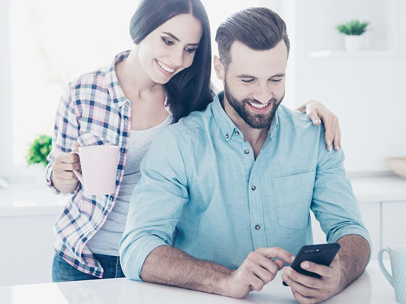 Happy man and wife using the Sentral for Parents App